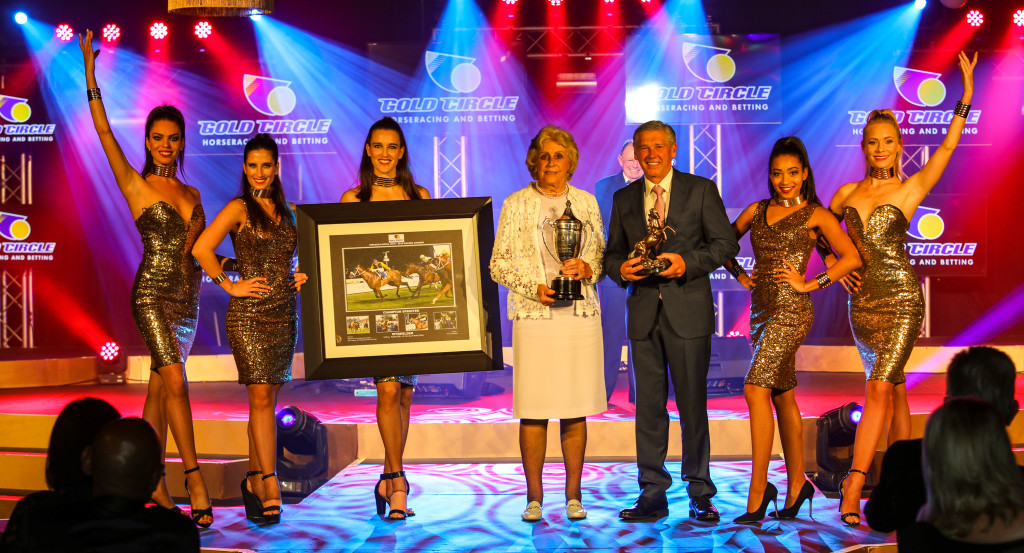 Mary Liley and trainer Tony Rivalland collect the award for Champion Sprinter.  Image: Candiese Marnewick